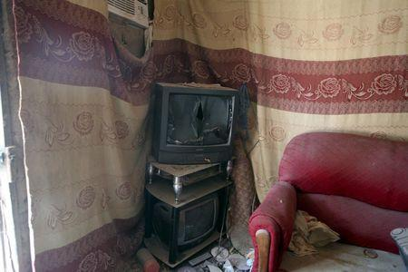 A television set is seen in a house that residents say was forcefully seized and occupied by a Boko Haram militant, in Damasak March 24, 2015. REUTERS/Joe Penney