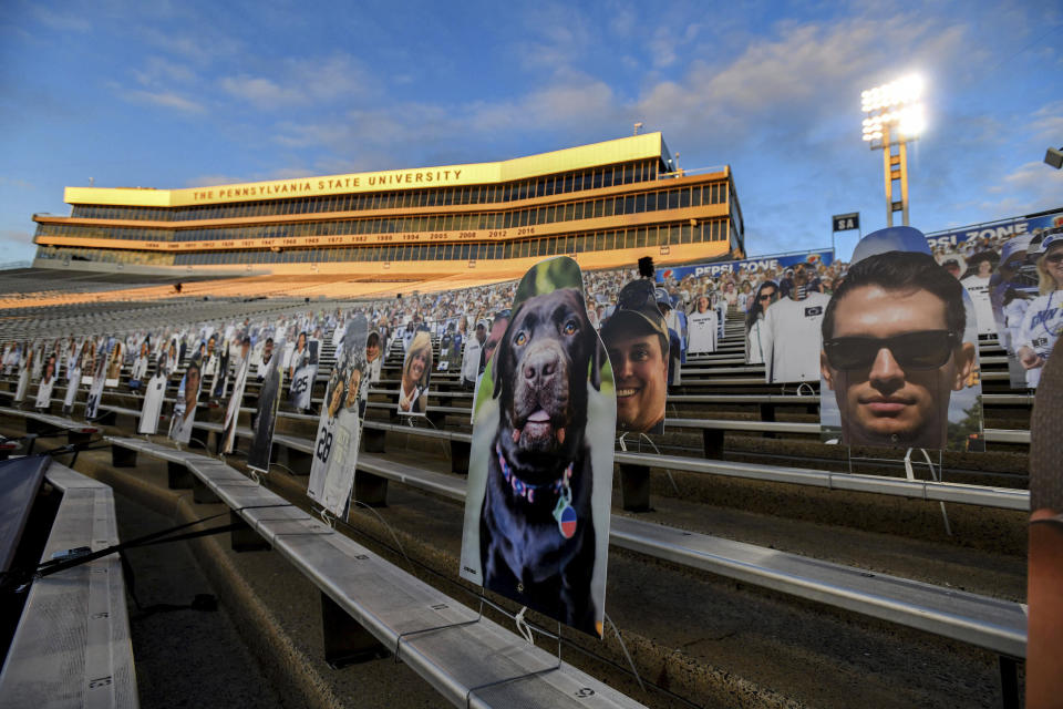 FILE - In this Oct. 31, 2020, file photo, cardboard cutouts of fans sit in the south stands before an NCAA college football game between Penn State and Ohio State in State College, Pa. In 2021, college football will attempt to return to normal after a season roiled by the pandemic while also adapting to a new paradigm in which the athletes have more power than ever before. (AP Photo/Barry Reeger, File)