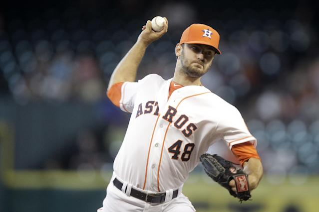Houston Astros pitcher Jarred Cosart throws during the first inning of a baseball game against the Tampa Bay Rays, Saturday, June 14, 2014, in Houston. (AP Photo/Patric Schneider)