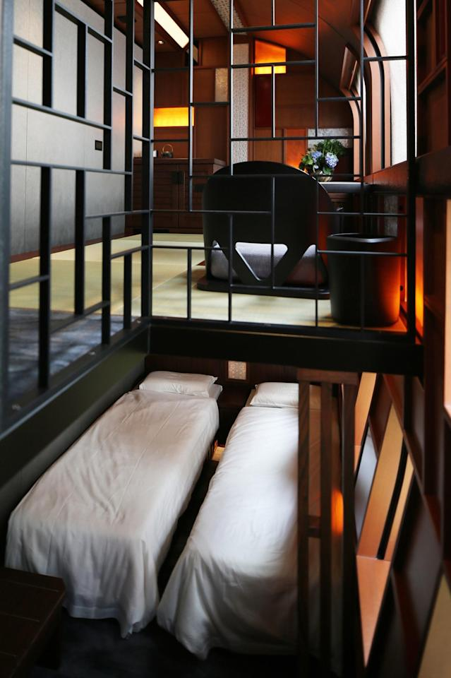 <p>Twin beds are shown below the dining area of the Shiki-shima Suite. (Photo: Asahi Shimbun via Getty Images) </p>