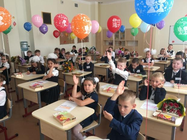 Temperature checks and no masks: School is back in Russia, but classes look much the same