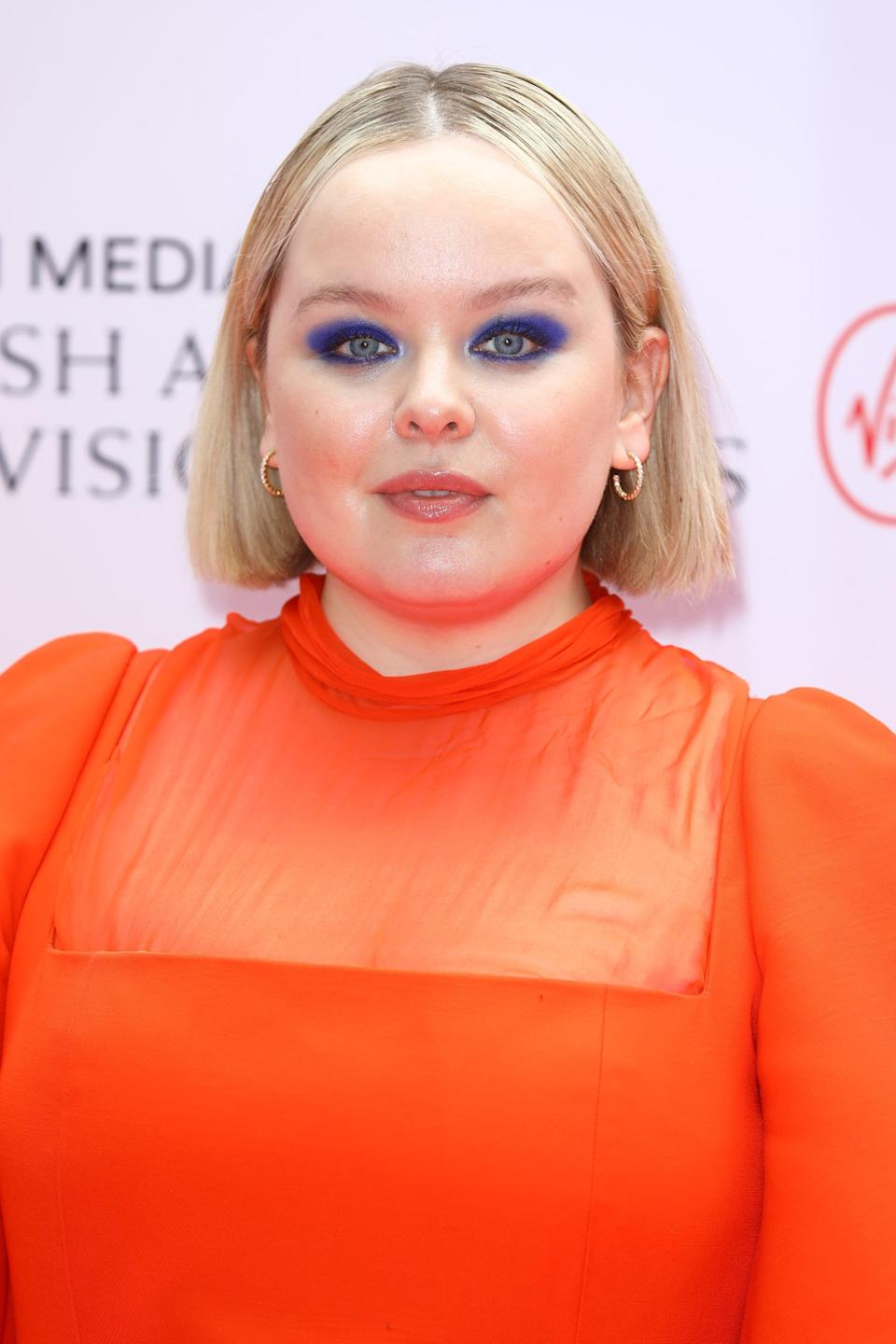 """<p>Coughlan's look for the night was all about vibrant colors. Makeup artist <a href=""""https://www.instagram.com/neilyoungbeauty/?hl=en"""" class=""""link rapid-noclick-resp"""" rel=""""nofollow noopener"""" target=""""_blank"""" data-ylk=""""slk:Neil Young"""">Neil Young</a> contrasted her vivid red dress with smoky eyes in the boldest shade of Yves Klein blue, dipping into the two cerulean colors found in the <span>Lancôme Hypnôse Palette in Bleu Hypnôtique</span> ($50).</p>"""