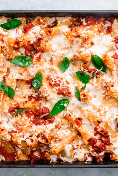 "<p>Wanna pack this baked ziti with even MORE veggies? Try throwing in some chopped red peppers, sliced <a href=""https://www.delish.com/uk/cooking/recipes/g28961915/courgette-recipes/"" rel=""nofollow noopener"" target=""_blank"" data-ylk=""slk:courgette"" class=""link rapid-noclick-resp"">courgette</a>, or swap the spinach for kale! Just because it's carb-y and cheesy doesn't mean it has to be totally unhealthy. </p><p>Get the <a href=""https://www.delish.com/uk/cooking/recipes/a30465665/vegetarian-baked-ziti/"" rel=""nofollow noopener"" target=""_blank"" data-ylk=""slk:Vegetarian Baked Ziti"" class=""link rapid-noclick-resp"">Vegetarian Baked Ziti</a> recipe.</p>"