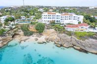 """<p>This Meads Bay property offers Caribbean luxury at its finest with modern glamour and Old-World charm by jewel-toned waters. The resort offers an all-inclusive vacation package that includes unlimited on-property and seaside adventures for all ages.</p><p><a href=""""https://aubergeresorts.com/malliouhana/"""" rel=""""nofollow noopener"""" target=""""_blank"""" data-ylk=""""slk:Mailliouhana, Auberge Resorts Collection"""" class=""""link rapid-noclick-resp"""">Mailliouhana, Auberge Resorts Collection </a>features rooms, suites, and villas that range from one- to four-bedroom accommodations to fit your clan comfortably. Afternoon tea, moonlit paddleboarding, water-centric wellness classes, and sailboat cruises down the coast are just the beginning of a lavish and memorable trip to Anguilla. </p>"""