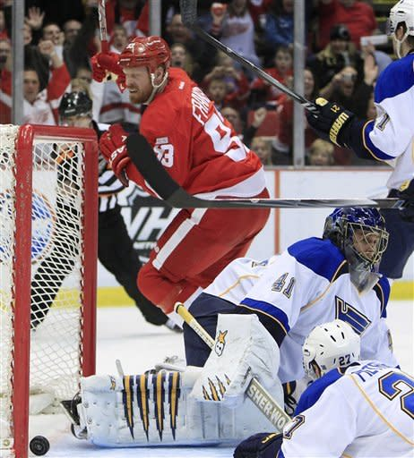 Detroit Red Wings right wing Johan Franzen (93), of Sweden, celebrates his goal against St. Louis Blues goalie Jaroslav Halak (41), of the Czech Republic, during the second period of an NHL hockey game in Detroit, Monday, Jan. 23, 2012. (AP Photo/Carlos Osorio)