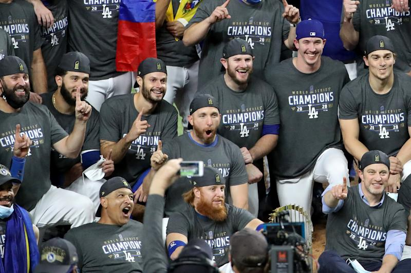 Justin Turner (bottom, middle) celebrates with teammates after winning the World Series. (Photo by Sean M. Haffey/Getty Images)