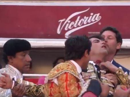 Arturo Macias is carried from the ring after being gored in the neck: Facebook/screengrab
