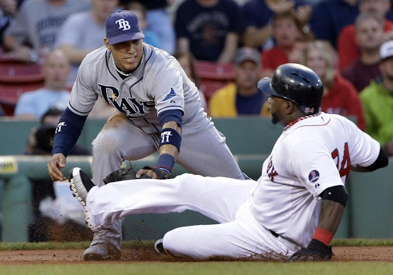 Boston Red Sox designated hitter David Ortiz (34) is tagged out by Tampa Bay Rays shortstop Yunel Escobar trying to reach third base from first on a single by Mike Napoli in the second inning of a baseball game at Fenway Park in Boston Tuesday, July 23, 2013. (AP Photo/Elise Amendola)