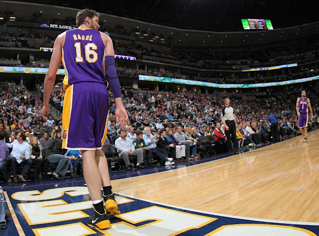 Los Angeles Lakers center Pau Gasol, of Spain, looks over his shoulder as he walks off court to lockerroom after suffering an injury against the Denver Nuggets in the first quarter of an NBA basketball game in Denver on Friday, March 7, 2014. (AP Photo/David Zalubowski)