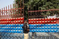A police officer stands guard at the entrance of the Central Prison in Karachi