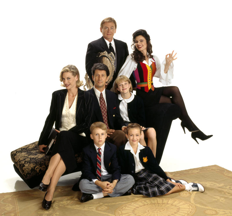 LOS ANGELES - JANUARY 1: The Nanny, a CBS television situation comedy. Premiere episode aired November 3, 1993. Pictured back row from left is Daniel Davis (as Niles), Fran Drescher (as Fran Fine); middle row from left is Lauren Lane (as C.C. Babcock), Charles Shaughnessy (as Maxwell Sheffield), Nicholle Tom (as Margaret 'Maggie' Sheffield). Seated in front from left is Benjamin Salisbury (as Brighton Sheffield), Madeline Zima (as Grace Sheffield). Image dated January 1, 1993. (Photo by CBS via Getty Images)