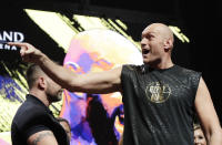 Tyson Fury, of England, yells during a weigh-in for his WBC heavyweight championship boxing match against Deontay Wilder, Friday, Feb. 21, 2020, in Las Vegas. (AP Photo/Isaac Brekken)