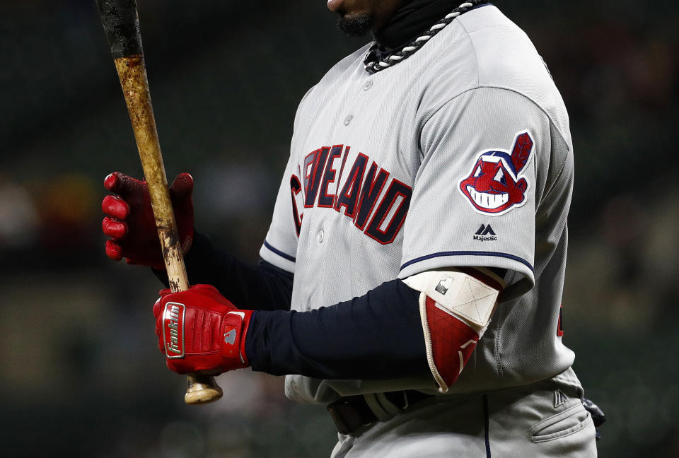 The Indians donned the Chief Wahoo logo on their sleeves and caps Monday. (AP Photo)