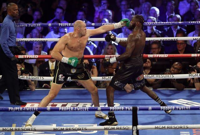 Tyson Fury, left, defeated Deontay Wilder 20 months ago (Bradley Collyer/PA)