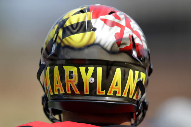 A Maryland player wears a helmet emblazoned with the state flag during an NCAA college football game against Richmond, Saturday, Sept. 5, 2015, in College Park, Md. (AP Photo/Patrick Semansky)