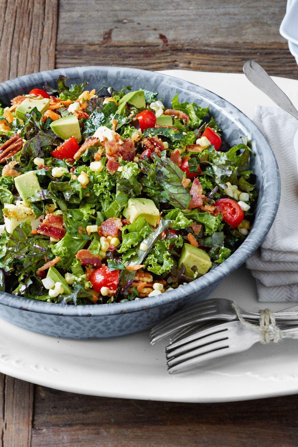 "<p>Tomatoes, pecans, bacon, and more top a hearty salad of kale and collards, which is meant to be served at room temperature.</p><p><a href=""https://www.countryliving.com/food-drinks/recipes/a4198/chopped-collard-kale-salad-lemon-garlic-dressing-recipe-clv0813/"" rel=""nofollow noopener"" target=""_blank"" data-ylk=""slk:Get the recipe."" class=""link rapid-noclick-resp""><strong>Get the recipe.</strong></a></p>"