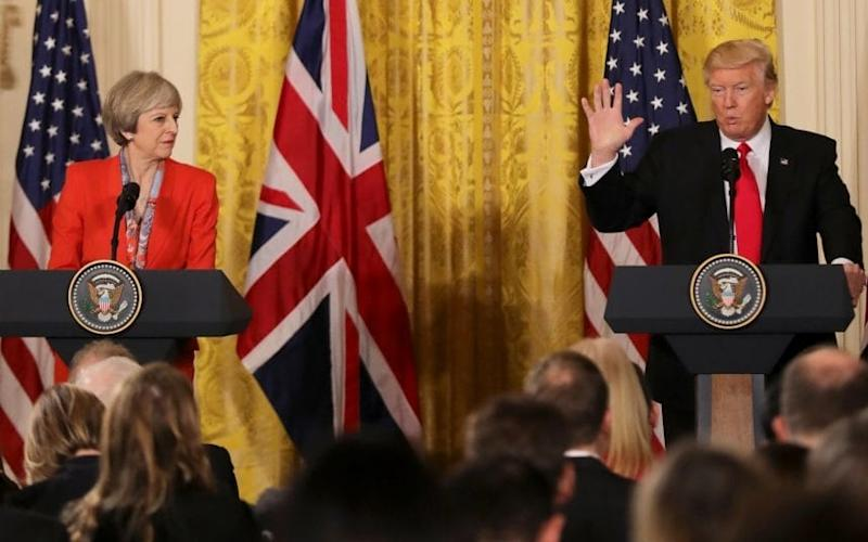 May and Trump take questions from the press - Credit: Christopher Furlong/Getty Images