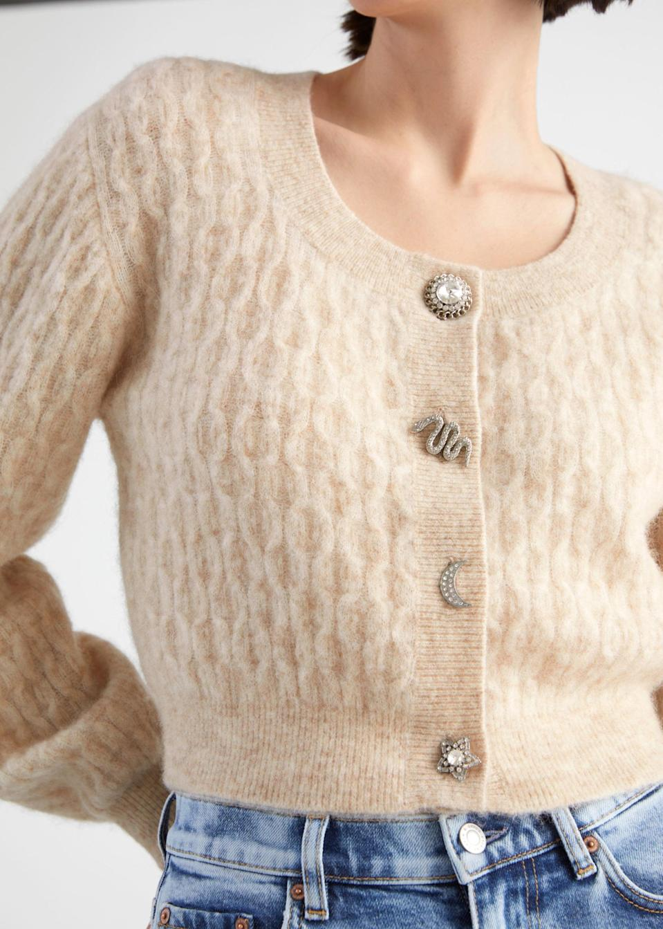 <p>This <span>&amp; Other Stories Novelty Button Alpaca Blend Cardigan</span> ($119) loos great with jeans.</p>
