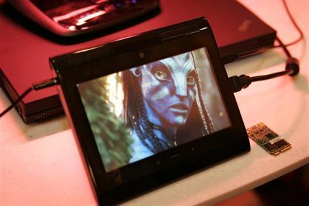 """A prototype Internet tablet plays an """"Avatar"""" movie trailer being streamed in 1080p high definition over a 4G LTE wireless network at CES in Las Vegas"""