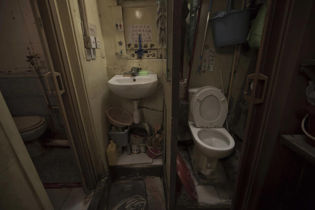 "<p>A set of grimy toilets and single sink shared by two dozen inhabitants, including a few single women, are located in an apartment in Hong Kong, March 28, 2017. In wealthy Hong Kong, there's a dark side to a housing boom, with hundreds of thousands of people forced to live in partitioned shoebox apartments, or ""coffin homes,"" and other types of inadequate housing. (Photo: Kin Cheung/AP) </p>"
