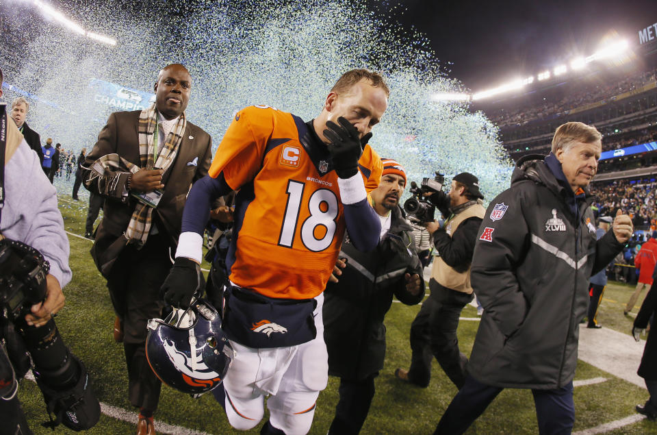 Peyton Manning leaves the field after losing Super Bowl XLVIII. (Getty Images)
