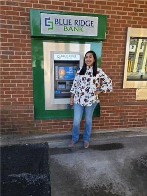 Blue Ridge Bank employee Daesha Graves at BRB's Mineral (Virginia) Branch Drive-Through ATM with Bitcoin capability.