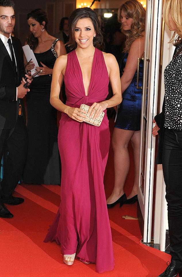 Eva Longoria looked ravishing at the Noble Gift Gala in London thanks to her raspberry-colored J. Mendel gown. (12/12/2011)