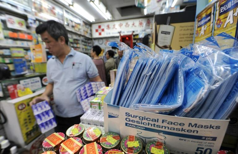Surgical face masks are ubiquitous in Hong Kong, not just in the winter flu season