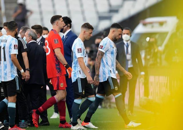 Argentina players walk off the pitch