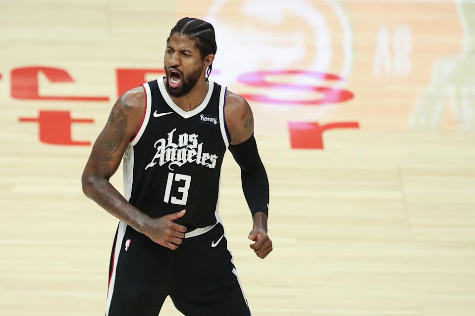 Clippers star Paul George celebrates during his team's Game 3 victory against the Phoenix Suns in the Western Conference finals. (Jevone Moore/Icon Sportswire via Getty Images)