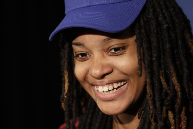 Chiquita Evans smiles after being selected as the 56th pick overall by the Warriors Gaming Squad at the NBA 2K League draft Tuesday, March 5, 2019, in New York. Evans is the first woman selected in the esports league. (AP Photo/Frank Franklin II)