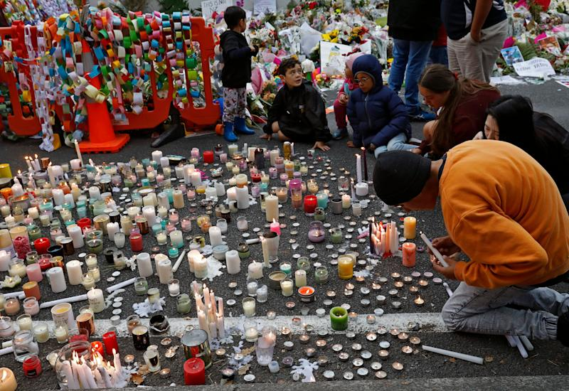 Students light candles as they gather for a vigil to commemorate victims of Friday's shooting, outside the Al Noor mosque in Christchurch, New Zealand, Monday, March 18, 2019. (Photo: Vincent Yu/AP)