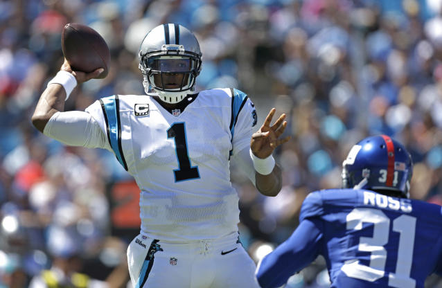Carolina Panthers quarterback Cam Newton (1) throws a pass under pressure from New York Giants cornerback Aaron Ross (31) during the first half of an NFL football game in Charlotte, N.C., Sunday, Sept. 22, 2013. (AP Photo/Bob Leverone)
