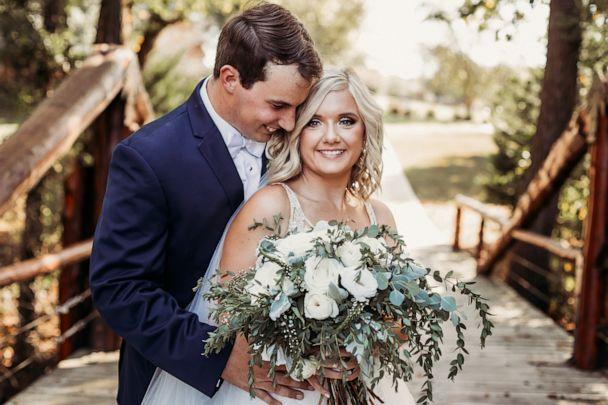 PHOTO: Lyndsey and Tanner Raby pose on their September 22, 2019, wedding day in in Benton, Tennessee. (Natalie Caho Photography)
