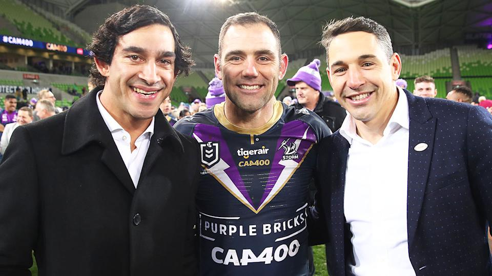 Cameron Smith (pictured middle) poses with Jonathan Thurston (pictured left) and Billy Slater (pictured right) after a game.