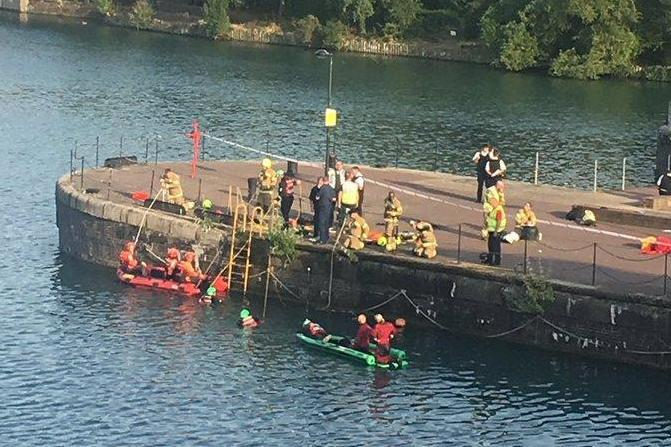 Emergency services at the scene at Shadwell Basin in Wapping, east London (Emma Reilly)