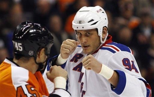 FILE - In this Nov. 4, 2010, file photo, Philadelphia Flyers' Jody Shelley, left, and New York Rangers' Derek Boogaard fight during an NHL hockey game in Philadelphia. TMZ reported Friday night Sept. 21, 2012 that Boogaard's family is suing the union to collect the $4.8 million remaining on the contract for their son, who died last year, and an additional $5 million in punitive damages. (AP Photo/Matt Slocum, File)
