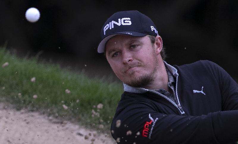 England's Eddie Pepperell plays a bunker shot on the 10th hole during the second round of the Dubai Desert Classic golf tournament in Dubai, United Arab Emirates, Friday, Jan. 24, 2020. (AP Photo/Kamran Jebreili)