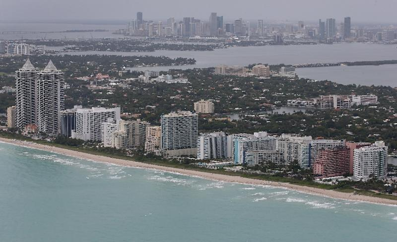 Miami's low elevation and porous limestone foundation mean that sea walls and levees will not help the city from eventually sinking, scientists say (AFP Photo/Joe Raedle)