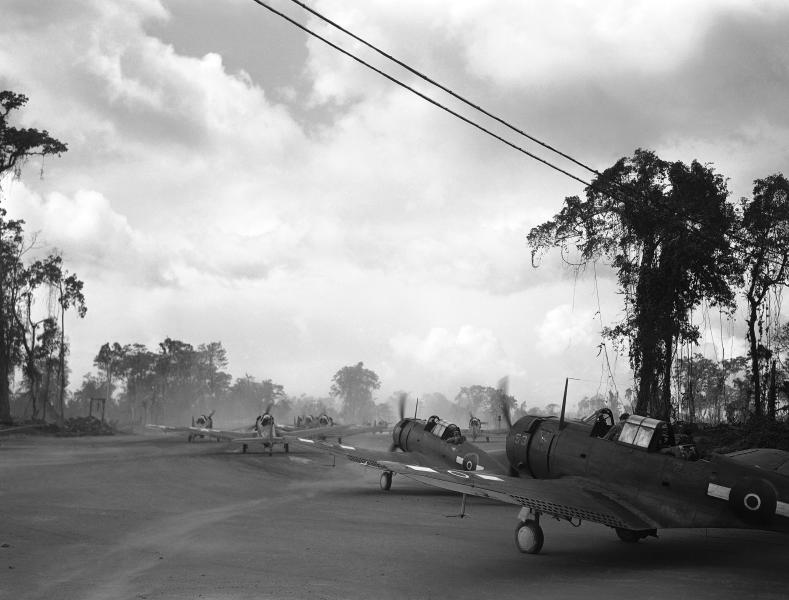 FILE - In this April 16, 1944, file photo, a combined force of American and Royal New Zealand Air Force dive bombers taxi to a runway on the island of Bougainville in Papua New Guinea. The island is where American fighters shot down Admiral Isoroku Yamamoto, the mastermind of the Pearl Harbor attack, making the wreck site one of most important of World War II. Now, 75 years later, a group from the U.S. and Japan is trekking to the remote Pacific island to document the site. (AP Photo/Frank Filan, File)