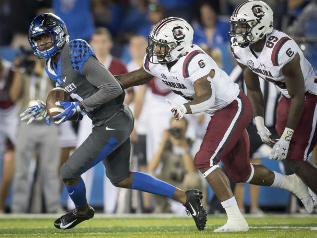 Kentucky cornerback Derrick Baity Jr. (8) catches an interception during the first half of an NCAA college football game against South Carolina in Lexington, Ky., Saturday, Sept. 29, 2018. (AP Photo/Bryan Woolston)