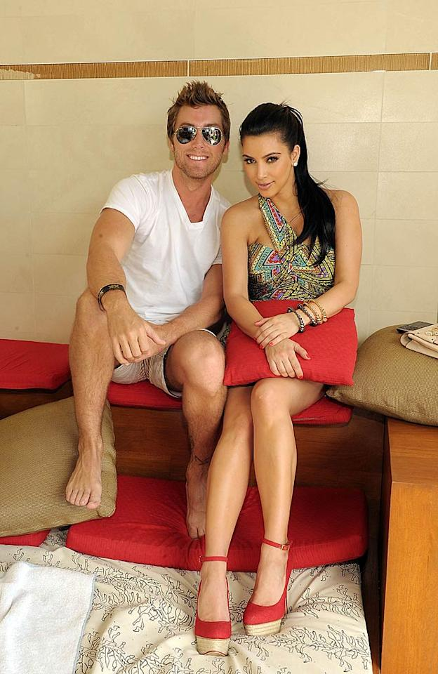 "Later, Kim was snapped lounging around in a private cabana with former *NSYNC boy bander Lance Bass before hopping a plane back to L.A. -- just in time to have dinner at her mom's house! Denise Truscello/<a href=""http://www.wireimage.com"" target=""new"">WireImage.com</a> - April 16, 2011"