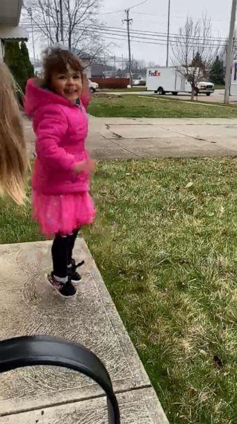 PHOTO: A 4-year-old named Ava jumped for joy as a fleet of FedEx trucks paraded through her Ohio, neighborhood after her birthday party was canceled due to the novel coronavirus shutdown. (Ashley Sarago)