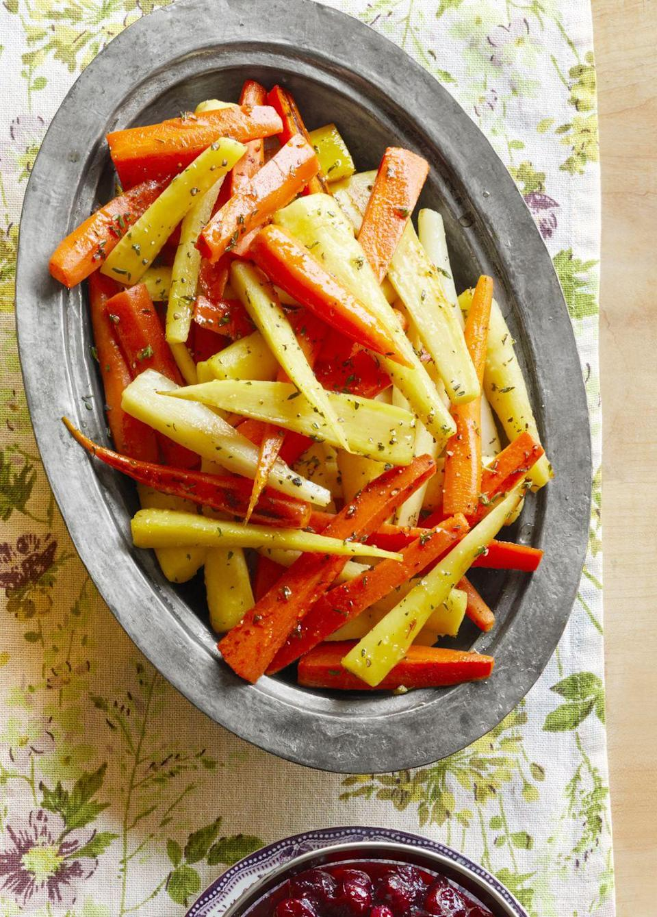 "<p>These fall-fresh veggies are perfect for your Turkey Day spread. This dish is savory, sweet, and downright delicious!</p><p><strong><a href=""https://www.thepioneerwoman.com/food-cooking/recipes/a33248884/honey-glazed-carrots-and-parsnips-recipe/"" rel=""nofollow noopener"" target=""_blank"" data-ylk=""slk:Get the recipe."" class=""link rapid-noclick-resp"">Get the recipe.</a></strong></p><p><a class=""link rapid-noclick-resp"" href=""https://go.redirectingat.com?id=74968X1596630&url=https%3A%2F%2Fwww.walmart.com%2Fbrowse%2Fhome%2Fserving-platters-trays%2F4044_623679_639999_2347672_7413764%3Ffacet%3Dbrand%253AThe%2BPioneer%2BWoman&sref=https%3A%2F%2Fwww.thepioneerwoman.com%2Ffood-cooking%2Fmeals-menus%2Fg33251890%2Fbest-thanksgiving-sides%2F"" rel=""nofollow noopener"" target=""_blank"" data-ylk=""slk:SHOP SERVING PLATTERS"">SHOP SERVING PLATTERS</a></p>"
