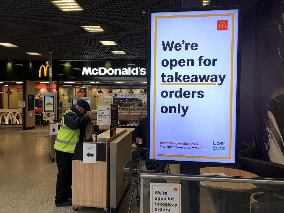 BRIGHTON - MARCH 20: A sign on a screen inside McDonalds telling customers they are open for takeaway orders only on March 20, 2020 in Brighton, England. Coronavirus (COVID-19) has spread to at least 182 countries, claiming over 10,000 lives and infecting almost 250,000. There have now been 3,269 diagnosed cases in the UK and 144 deaths. (Photo by Mike Hewitt/Mike Hewitt/Getty Images)