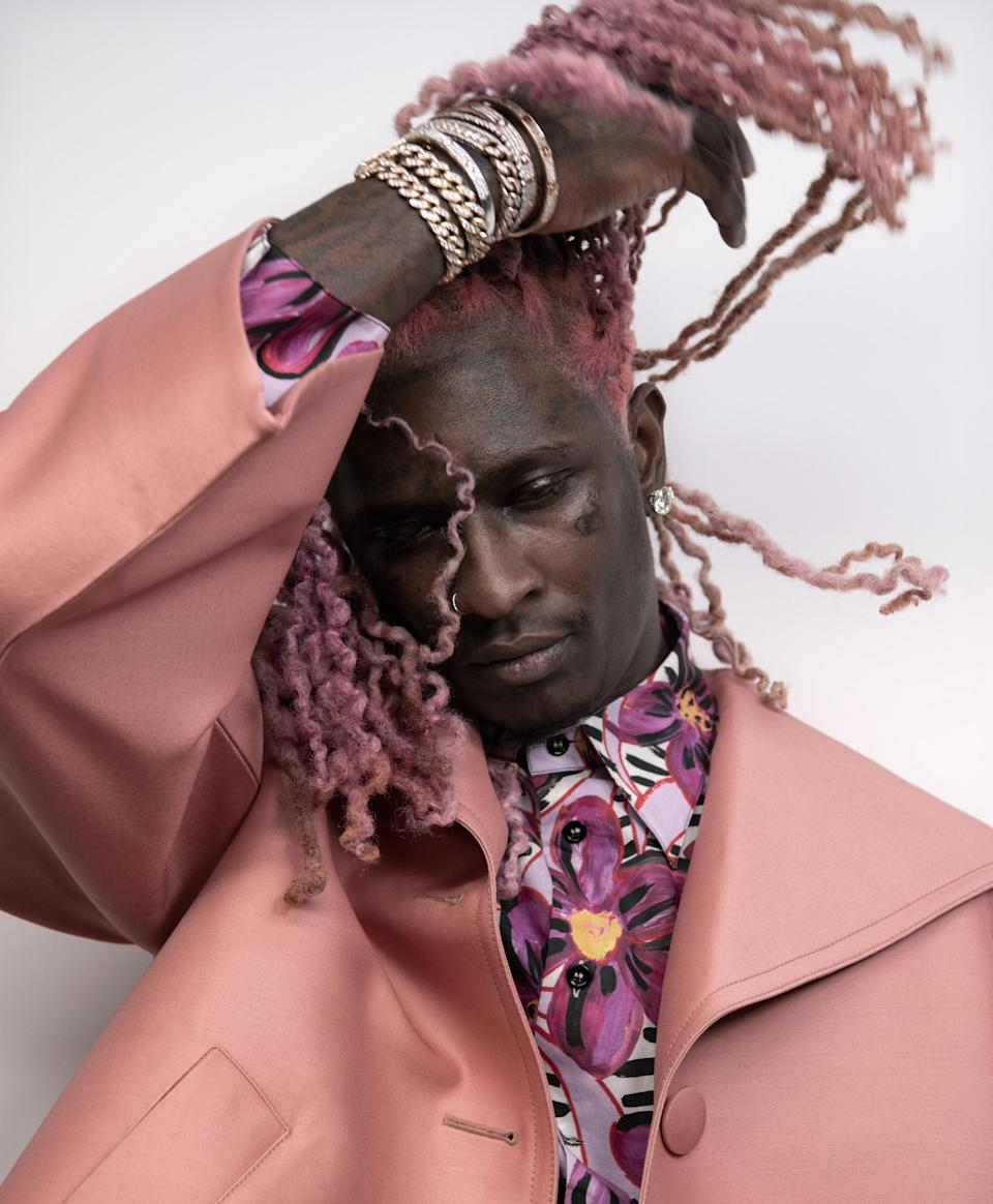 Young Thug photographed in Los Angeles, California, in July 2021. Coat by Lanvin. Shirt by Marni. Jewelry by Rafaello & Co. - Credit: Jackie Nickerson for Rolling Stone.