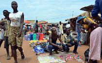 "People walk through the main market at ""Kilometre Five"" in Bangui on May 18, 2015, where refugees, mostly Muslims, gathered during inter-relgious violence that wracked the Central African Republic in December 2013 (AFP Photo/Patrick Fort)"