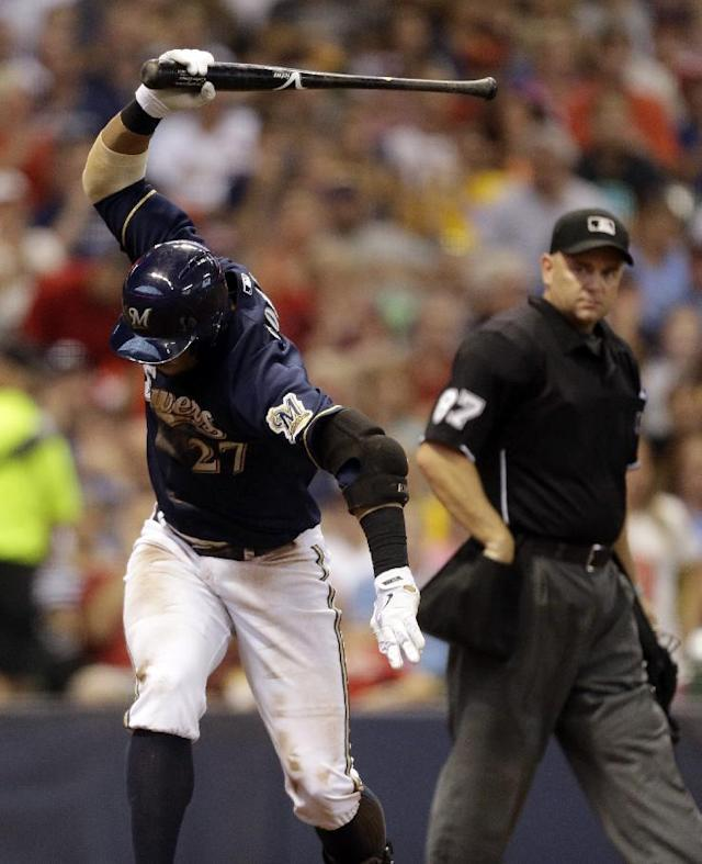 Milwaukee Brewers' Carlos Gomez reacts after striking out during the fifth inning of a baseball game against the St. Louis Cardinals Saturday, July 12, 2014, in Milwaukee. (AP Photo/Jeffrey Phelps)