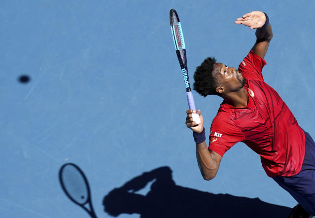Gael Monfils of France serves to Ernests Gulbis of Latvia during their third round singles match at the Australian Open tennis championship in Melbourne, Australia, Saturday, Jan. 25, 2020. (AP Photo/Lee Jin-man)