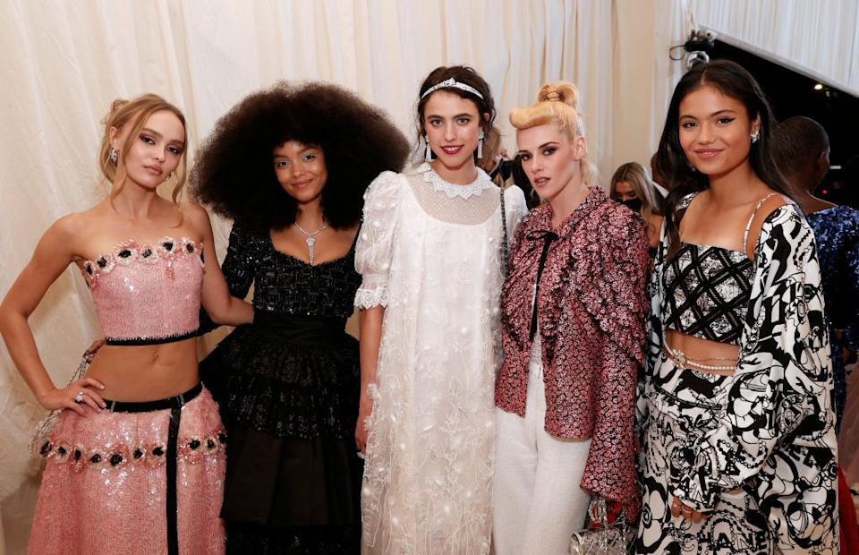 Emma Raducanu looks right at home posing with (L-R) Lily-Rose Depp, Whitney Peak, Margaret Qualley and Kristen Stewart at last night's Met Gala. (Getty Images)